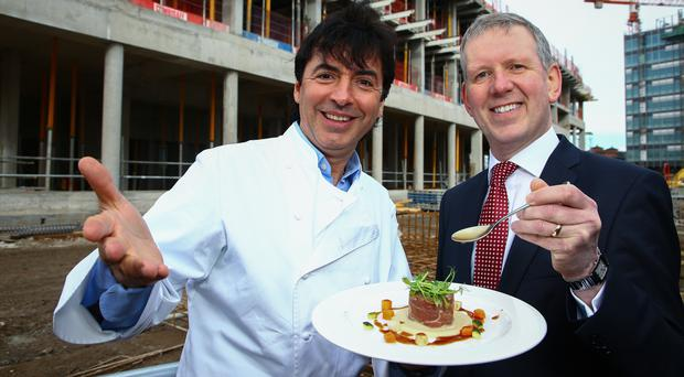 Chef Jean-Christophe Novelli with Belfast Harbour's property director Graeme Johnston outside the partly-constructed Marriott AC Hotel