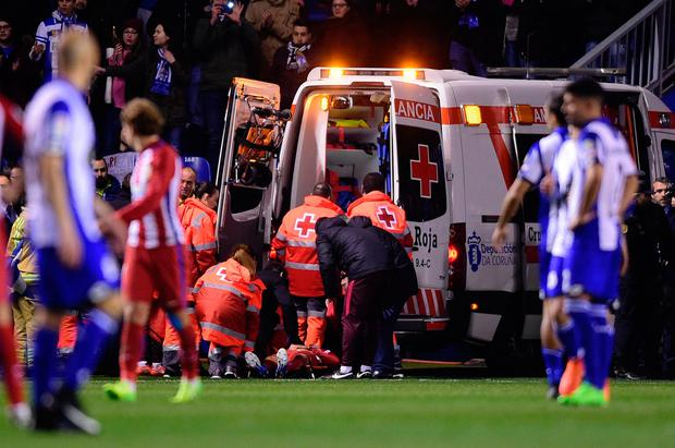 Atletico Madrid's forward Fernando Torres is evacuated in an ambulance due to an injury during the Spanish league football match RC Deportivo de la Coruna vs Club Atletico de Madrid at the Municipal de Riazor stadium in La Coruna on March 2, 2017. The match ended with a 1-1 draw. /AFP/Getty Images