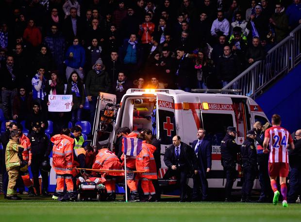 Atletico Madrid's forward Fernando Torres is evauated in an ambulance after colliding with Deportivo La Coruna's midfielder Alex Bergantinos during the Spanish league football match RC Deportivo de la Coruna vs Club Atletico de Madrid at the Municipal de Riazor stadium in La Coruna on March 2, 2017. The match ended with a 1-1 draw. AFP/Getty Images