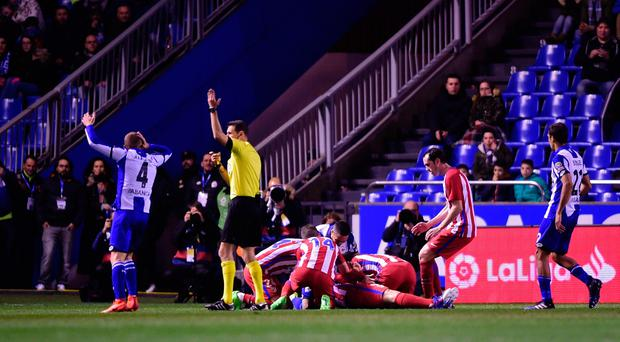 Referee calls for medical assistance after Atletico Madrid's forward Fernando Torres got an injury during the Spanish league football match RC Deportivo de la Coruna vs Club Atletico de Madrid at the Municipal de Riazor stadium in La Coruna on March 2, 2017. The match ended with a 1-1 draw. AFP/Getty Images
