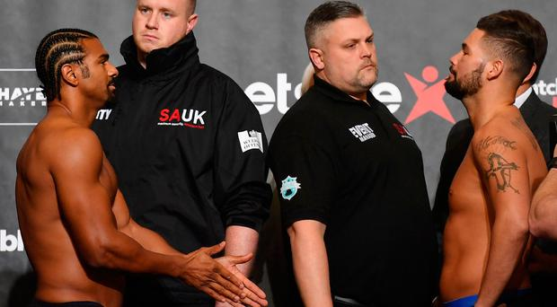 Facing off: David Haye and Tony Bellew stare each other down at the weigh-in ahead of their heavyweight clash at London's O2 Arena