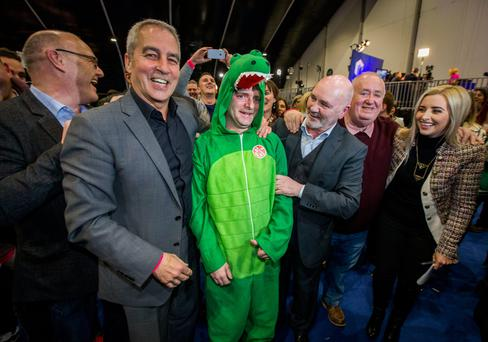 An Irish Language Act supporter dressed in crocodile costume celebrates with Sinn Fein politicians yesterday