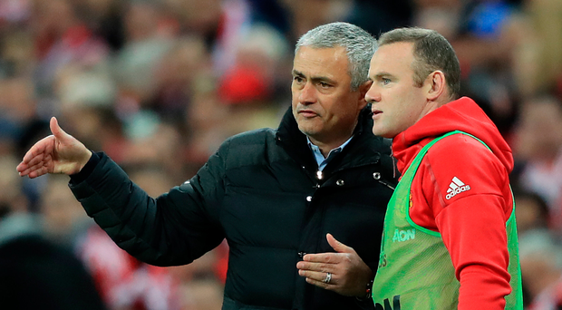 Talking tactics: Jose Mourinho gives Wayne Rooney instructions at Wembley but United's late winner meant he didn't get on