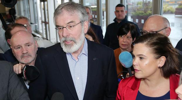 Sinn Fein President Gerry Adams talks to the media as he arrives at the count centre
