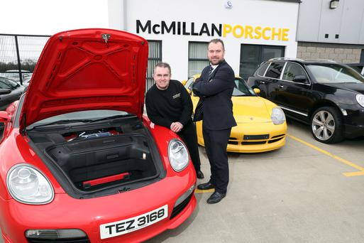 George McMillan (left) and Ulster Bank's Conor McNeill at McMillan Porsche's new premises in Antrim