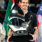 Confident: Andy Murray with the trophy after Dubai success