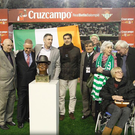 Centre stage: Members of the Patrick O'Connell Memorial Fund unveil the bust ahead of Real Betis' clash with Sociedad on Friday night