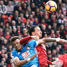 Tough day: Zlatan Ibrahimovic catches Tyrone Mings