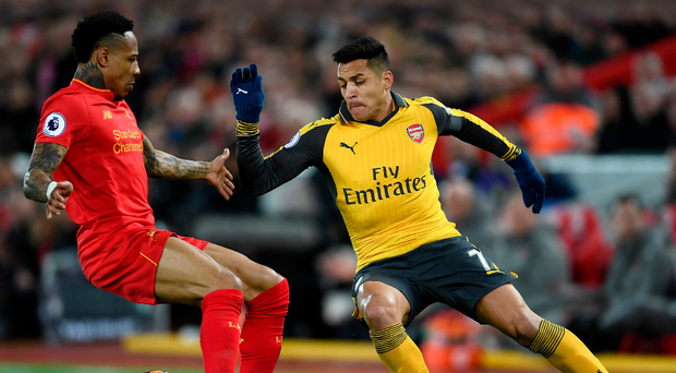 Benched: Alexis Sanchez was dropped for the defeat to Liverpool