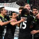 STRATFORD, ENGLAND - MARCH 06: Diego Costa of Chelsea celebrates with team mates after scoring his sides second goal during the Premier League match between West Ham United and Chelsea at London Stadium on March 6, 2017 in Stratford, England. (Photo by Michael Regan/Getty Images)