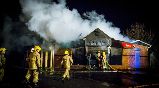 Firefighters battle a blaze at the former Brook Lodge bar in the Twinbrook area of West Belfast on March 6th 2017 (Photo - Kevin Scott / Belfast Telegraph )