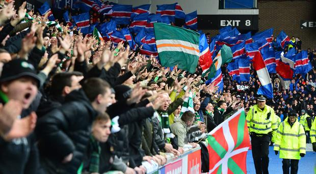 Celtic and Rangers fans at a match. Photo by Mark Runnacles/Getty Images
