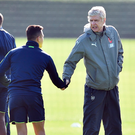 No hard feelings: Arsene Wenger shakes hands with Alexis Sanchez before training yesterday