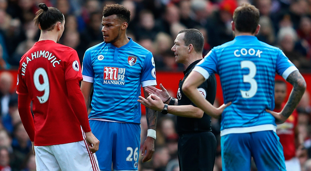 FA action: Zlatan Ibrahimovic and Tyrone Mings are spoken to by ref Kevin Friend, who didn't see either contentious incident