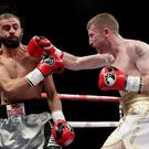 Boxing clever: Paddy Barnes on the way to victory over Stefan Slavchev at the Titanic Exhibition Centre on his professional debut