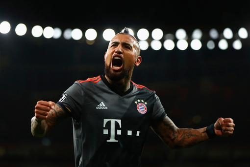 LONDON, ENGLAND - MARCH 07: Arturo Vidal of Bayern Muenchen celebrates as he scores their fourth goal during the UEFA Champions League Round of 16 second leg match between Arsenal FC and FC Bayern Muenchen at Emirates Stadium on March 7, 2017 in London, United Kingdom. (Photo by Clive Mason/Getty Images)