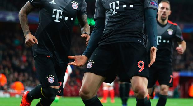 Here we go: Robert Lewandowski celebrates drawing Bayern level on the night ahead of his side turning on the style to blow the Gunners away