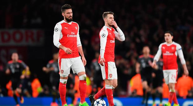 Painful: Arsenal's Olivier Giroud (left) and Aaron Ramsey look shell-shocked
