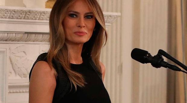 WASHINGTON, DC - MARCH 08: First lady Melania Trump attends at a luncheon she was hosting to mark International Women's Day in the State Dining Room at the White House March 8, 2017 in Washington, DC. (Photo by Mark Wilson/Getty Images)