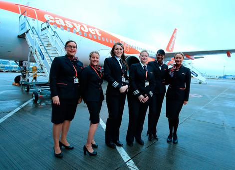 Captain Kate McWilliams (third from left) poses for picture with her crew before an EasyJet flight from Gatwick Airport prepared and operated entirely by women to mark International Women's Day. Gareth Fuller/PA Wire