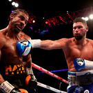 Tony Bellew (right) lands a punch on David Haye during the heavyweight contest at The O2 on Saturday night. P: Nick Potts/PA Wire