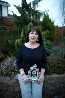 Kate Carroll with a photograph of her husband Stephen a PSNI officer who was murdered by terrorists 7 years ago