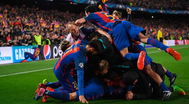 Unbelievable: Barcelona celebrate last night's breathtaking result against PSG at the Nou Camp