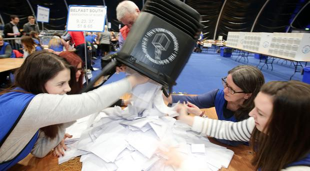 Election workers count parties' votes after the Assembly poll