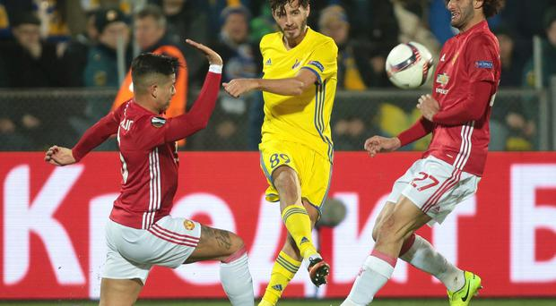 Manchester United's Marcos Rojo, left, Manchester United's Marouane Fellaini, right, and Rostov's Aleksandr Erokhin fight for the ball during the Europa League round of 16 first leg soccer match between Rostov and Manchester United in Rostov-on-Don, Russia, Thursday, March 9, 2017. (AP Photo/Denis Tyrin)