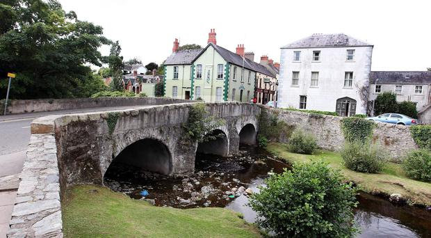 Rostrevor lies at the foot of Slieve Martin and on the coast of Carlingford Lough. A bridge on the Cloughmore Road over the Kilbroney River