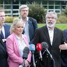 Sinn Fein's Stormont leader Michelle O'Neill and President Gerry Adams lead their party from Stormont Castle,