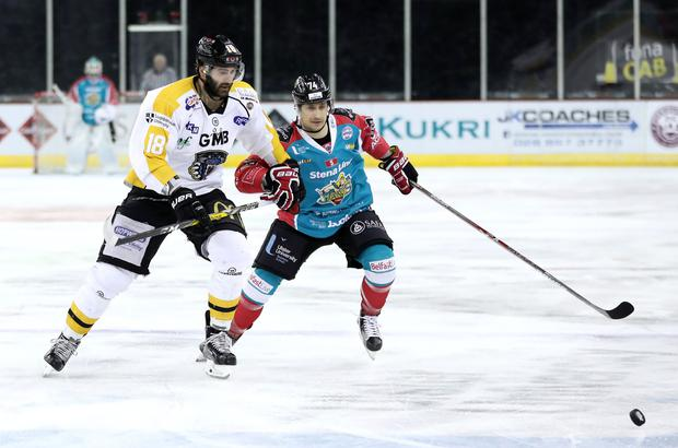 Belfast Giants' Matt Towe with Nottingham Panthers' Chris Lawrence during Friday nights Elite Ice Hockey League game at the SSE Arena, Belfast. PressEye