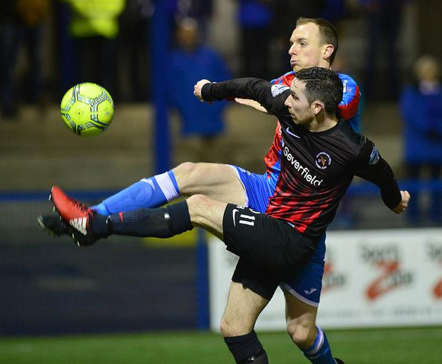 Ards v Ballinamallard Danske Bank Premiership. Ards Greg Hall and ÔMallardÕs Jay McCartney pictured in action during this evenings game at the Bangor Fuels arena in Northern Ireland. Arthur Allison/Pacemaker Press