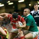 Wales' Leigh Halfpenny (centre) is tackled by Ireland's Simon Zebo (right) on his own line during the RBS Six Nations at the Principality Stadium, Cardiff. PRESS ASSOCIATION David Davies/PA Wire