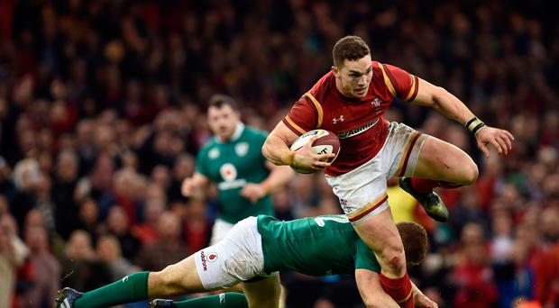 Wales' George North is tackled by Ireland's Robbie Henshaw during the RBS Six Nations at the Principality Stadium, Cardiff. Joe Giddens/PA Wire.