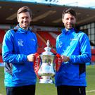 Hands-on: Lincoln City manager Danny Cowley (right) and brother/assistant Nicky pose with the Emirates FA Cup
