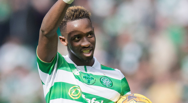 Ball boy: Moussa Dembele after his treble against Gers
