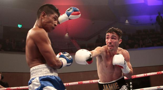 Major hit: Jamie Conlan lands a blow on Yader Cardoza