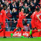 Liverpool's Emre Can (centre) celebrates scoring his side's second goal during the Premier League match at Anfield, Liverpool. Peter Byrne/PA Wire.