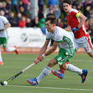 Hot shot: Irish marksman Matthew Nelson races into Austria's circle during yesterday's draw