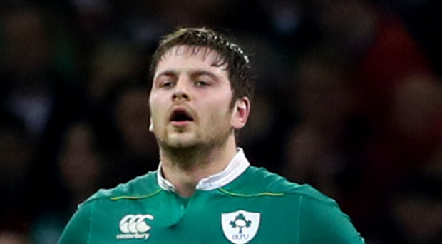 Dream dies: Ireland's Iain Henderson feels the pain of defeat at the final whistle in Cardiff