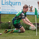 Not enough: Ballynahinch's Paddy Wright scores a try against Old Wesley