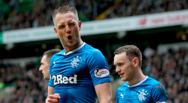 Old stager: Clint Hill salutes the Rangers support after his late leveller