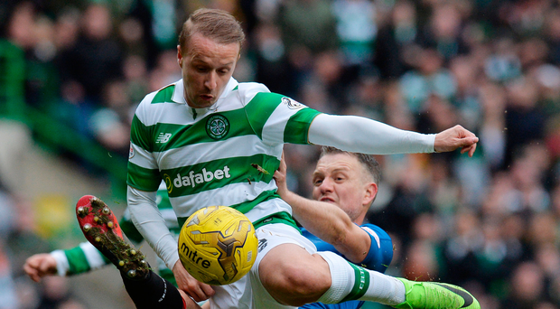Controversial: Clint Hill tackles Celtic's Leigh Griffiths