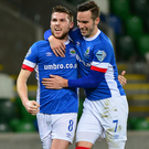 Victory roar: Linfield's Stephen Lowry and Andy Waterworth