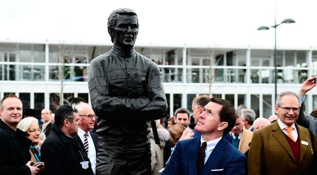 Sir AP McCoy poses alongside a statue of himself which was unveiled during Champion Day of the Cheltenham Festival at Cheltenham Racecourse on March 14, 2017 in Exeter, England. (Photo by Harry Trump/Getty Images)