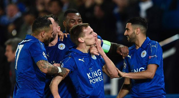 Leicester City's English midfielder Marc Albrighton (C) celebrates scoring their second goal during the UEFA Champions League round of 16 second leg football match between Leicester City and Sevilla at the King Power Stadium on March 14, 2017. AFP/Getty Images