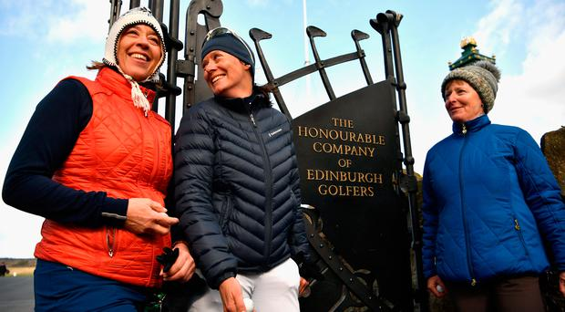 Anna Diertrich, Pascale Reinhard and Janet Siehnthiler from Switzerland stand outside Muirfield Golf Club yesterday following their round of golf after the club members voted to admit women members. Photo: Jeff J Mitchell/Getty Images