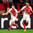 Monaco's French forward Kylian Mbappe Lottin (C) celebrates with Monaco's Portuguese midfielder Bernardo Silva (L) and Monaco's French midfielder Thomas Lemar (R) after scoring a goal during the UEFA Champions League round of 16 football match between Monaco and Manchester City at the Stade Louis II in Monaco on March 15, 2017. / AFP PHOTO / Pascal GUYOTPASCAL GUYOT/AFP/Getty Images