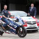 Fresh wheels: Alastair Seeley shows off his new Tyco BMW Superbike alongside Keith Hyde of Charles Hurst Vauxhall